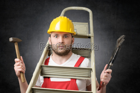 clumsy worker with tools