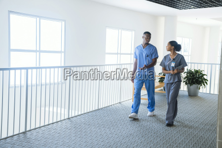 nurses walking and talking