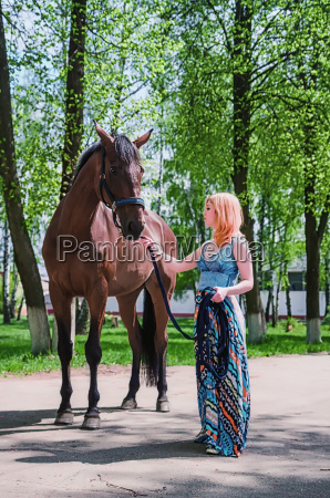 young woman with a horse