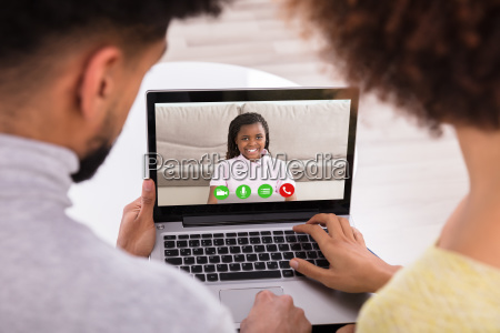 couple video conferencing with daughter on