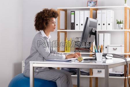 young businesswoman working on computer at