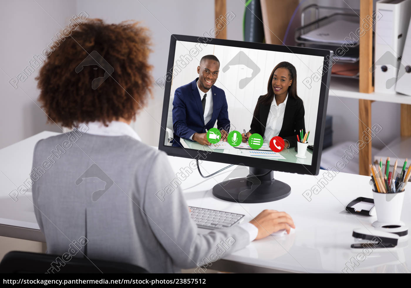 Royalty free photo 23857512 - Businesswoman Video Conferencing Colleagues