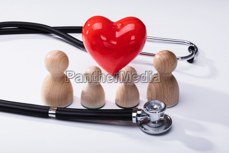 wooden pawns red heart shape and