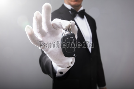 waiter holding car key