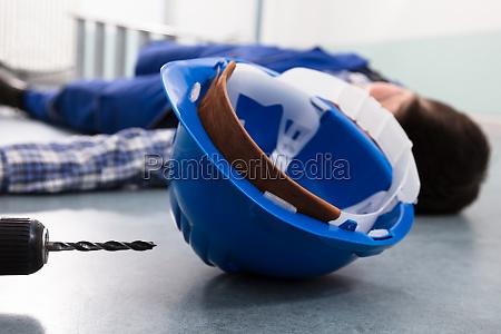 handymans helmet with unconscious handyman