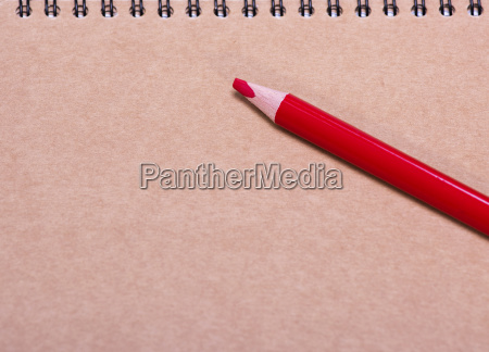 red wooden pencil on a brown