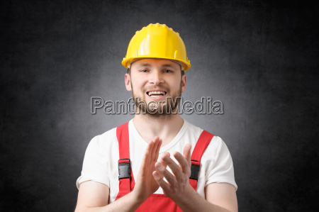 construction worker clapping his hands
