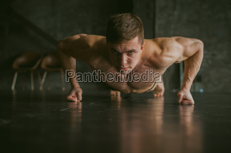 young sexy male bodybuilder athlete with