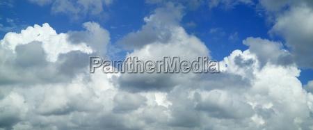 puffy white clouds against a blue