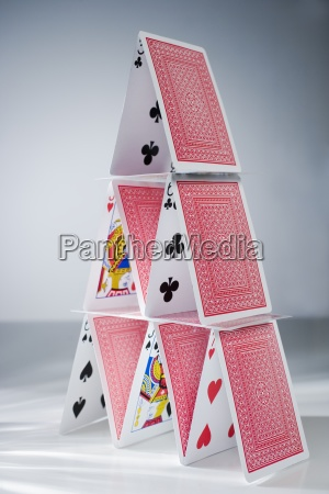 playing cards stacked into a pyramid