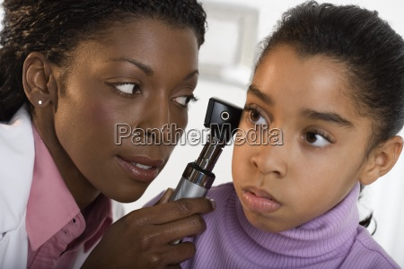 girl getting check up from pediatrician