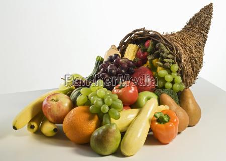 fruits and vegetables in cornucopia basket