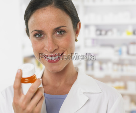 close up of female pharmacist holding