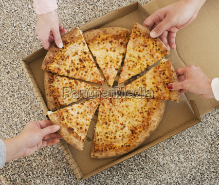 people talking slices of pizza from