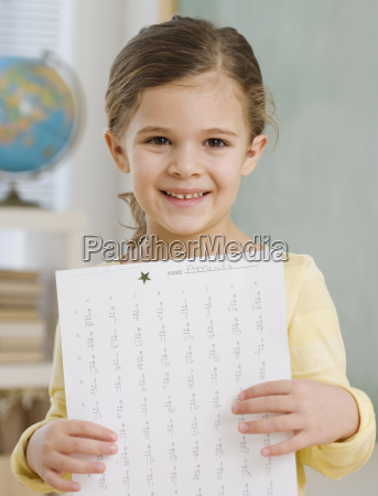 portrait of girl holding paper in