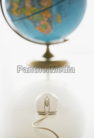 computer mouse in front of globe