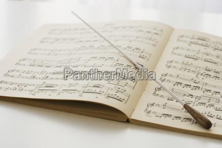 conductors baton on sheet music