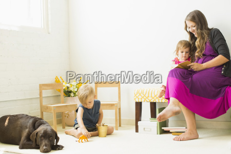 mother reading to daughter 2 3