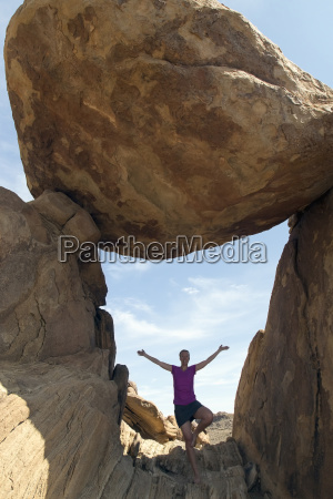 portrait of woman visiting balanced rock