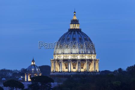 illuminated st peters basilica at dusk