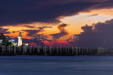 lighthouse with dramatic sky in background