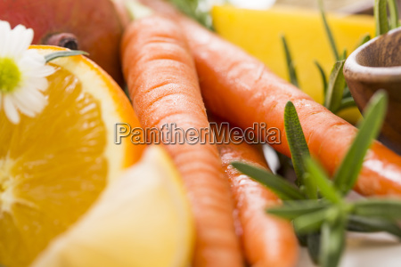 slice of orange with carrots and