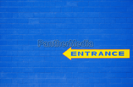 blue wall with yellow entrance sign