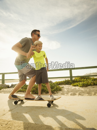 father skateboarding with his son 6