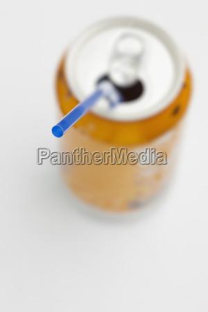blue straw in open soda can