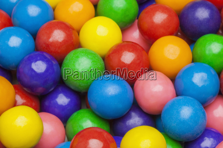 close up of multi colored gumballs