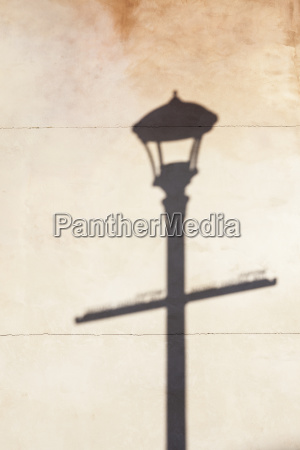 shadow of street lamp on wall