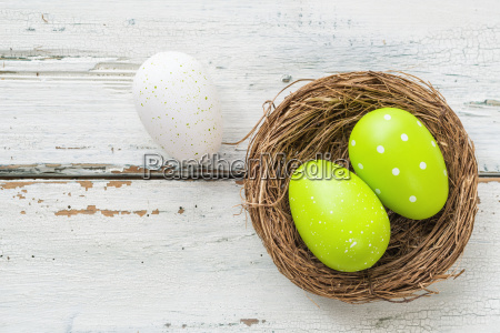 easter nest with green easter eggs