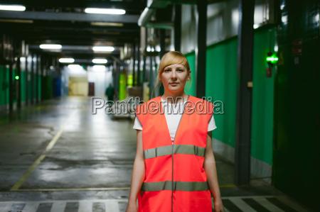 female employee in an orange robe