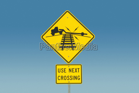 yellow road sign depicting truck on