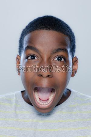 portrait of teenage boy 14 15