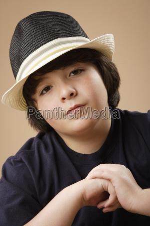 studio portrait of boy 10 11