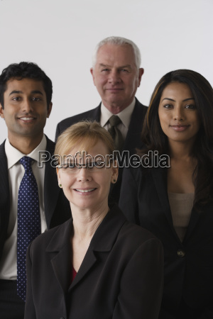 portrait of four business people studio