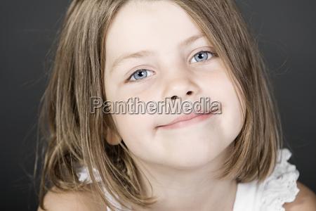 studio portrait of smiling girl 6