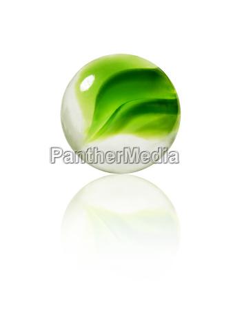 studio shot of green marbles arranged