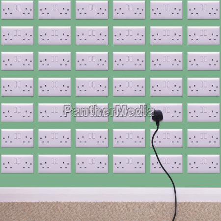 wall covered in electrical outlets