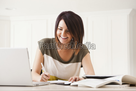 portrait of young woman learning at
