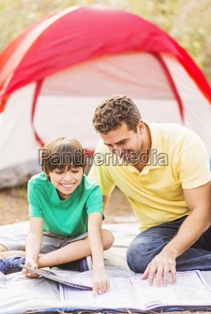 father and son 12 13 camping