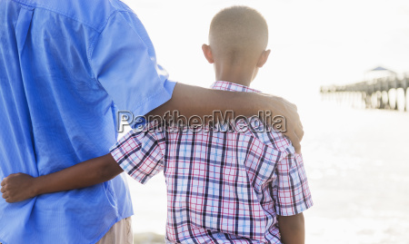 father and son 10 11 embracing