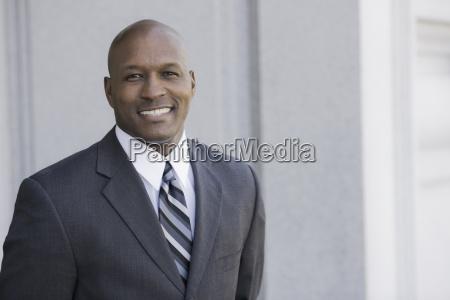 portrait of businessman smiling outdoors san