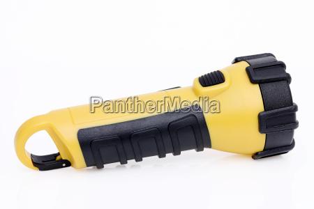 electric led pocket flashlight on white