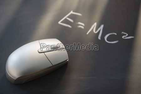 computer mouse on blackboard