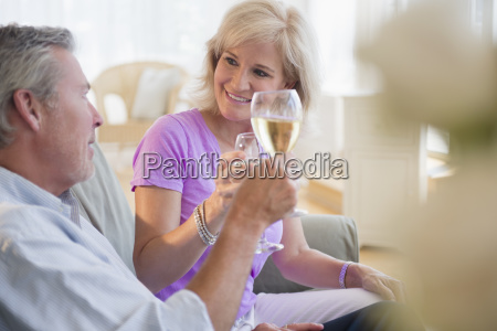 portrait of couple sitting on sofa