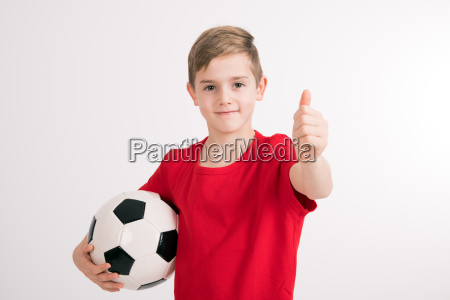 boy in red shirt with soccer
