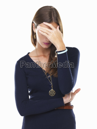 stressed woman with hand on forehead
