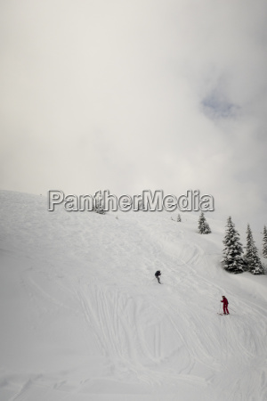 two skiers off the piste